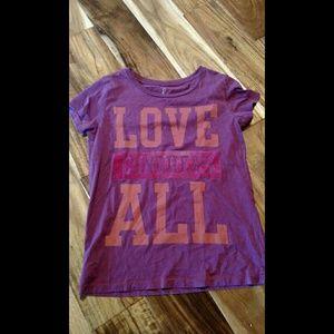 Peek Love Conquers All Tshirt.